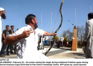 APP01-25 ISLAMABAD: February 25 – An archer aiming the target during traditional Pukhtun game during Social Sciences Expo-2016 held at Pak-China Friendship Centre. APP photo by Javed Qureshi