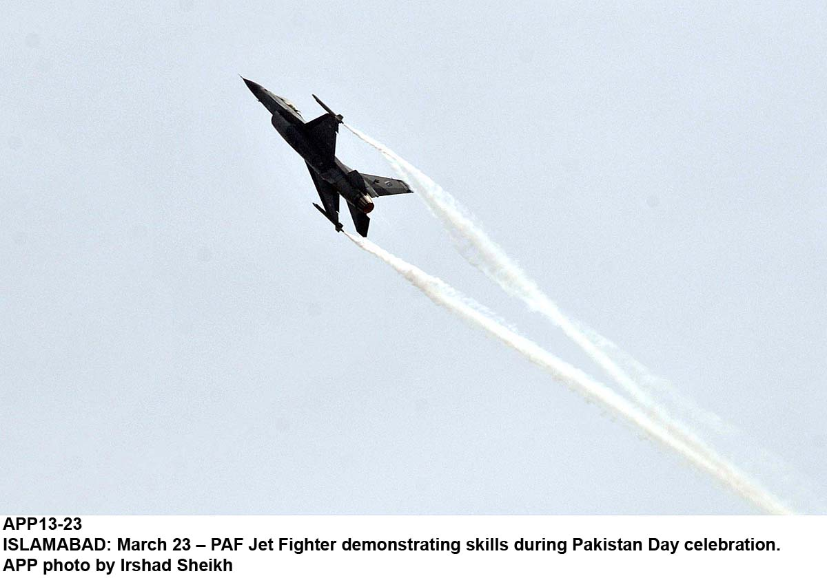 APP13-23 ISLAMABAD: March 23 – PAF Jet Fighter demonstrating skills during Pakistan Day celebration. APP photo by Irshad Sheikh