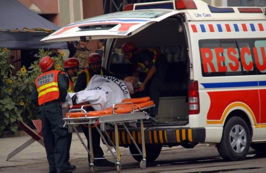 LAHORE,PAKISTAN - MAY 28:  Rescue personnel load an injured man into an ambulance at the scene of an attack and siege mosque in the area of Garhi Shahu on May 28, 2010 in Lahore, Pakistan.  Gunmen attacked two mosques in the Pakistani city of Lahore today. The gunmen took hostages from among people gathered for Friday prayers in at least one building. Over 30 people were killed in the attack, responsibility of which has been claimed by the Tehreek-e-Taliban Pakistan (TTP).  (Photo by Nadeem Ijaz/Getty Images)