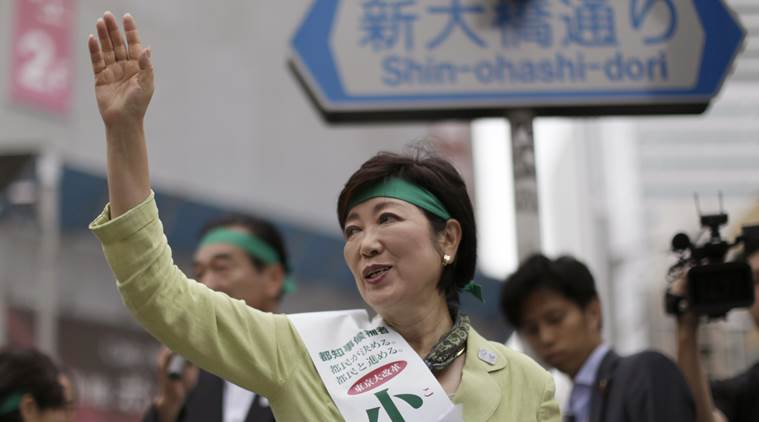 In this Friday, July 22, 2016 photo, former defense minister Yuriko Koike waves at passersby during her campaign rally for the Tokyo gubernatorial election in Tokyo. Japan's capital with a population of more than 13 million people is voting Sunday, July 31, for its leader after two predecessors resigned over money scandals as Tokyo prepares to host the 2020 Olympics, and hopes to lead the nation in an economic turnaround. (AP Photo/Eugene Hoshiko)
