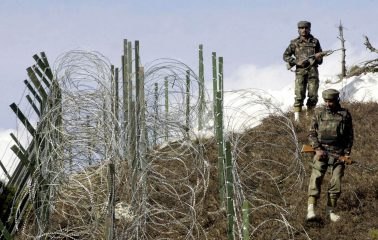 "(FILES) This file photograph taken on December 4, 2003, shows Indian soldiers as they patrol along a barbed-wire fence near Baras Post on the Line of Control (LoC) between Pakistan and India some 174 kms north west of Srinagar.   India's military has carried out ""surgical strikes"" along the de facto border with Pakistan in Kashmir to thwart a series of attacks being planned against major cities, the army said September 29, 2016. Pakistan's military however accused India of killing two of its soldiers in ""unprovoked firing"" along the Line of Control that divides the disputed territory and said its troops had responded.  / AFP PHOTO / SAJJAD HUSSAINSAJJAD HUSSAIN/AFP/Getty Images"