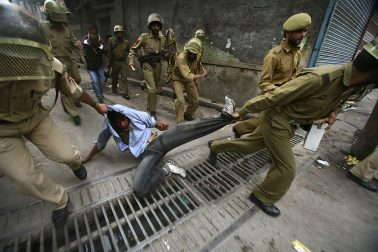 Policemen detain a Kashmiri protester, during a demonstration against the Indian general elections, in Srinagar, India, Tuesday, April 28, 2009. (AP Photo/Mukhtar Khan)